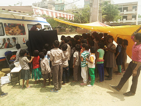 Children of NGO Nai Kiran, Ardee City, Gurgaon watching a puppet show on Dengue awareness