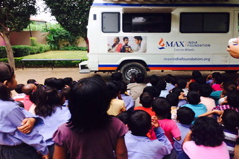 Children watching Film on Hand-washing at our Mobile Health Van Screen