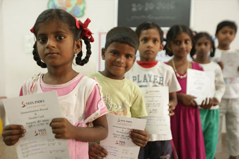 Children with their MIF Health Cards
